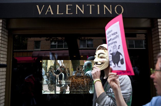 "Protestors affiliated with the ""Occupy Wall Street"" protests march past a Valentino store on East 65th Street in New York, on Tuesday, Oct. 11, 2011. The crowd marched through out the Upper East Side"