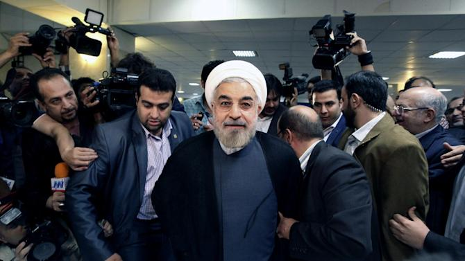 Former Iranian nuclear negotiator Hasan Rowhani, center, arrives at the interior ministry to register his candidacy for the upcoming presidential election, in Tehran, Iran, Tuesday, May 7, 2013. Iranian authorities opened the registration process Tuesday for candidates in next month's presidential election that will pick a successor to President Mahmoud Ahmadinejad and offer a critical test for reformists battered after years of crackdowns. (AP Photo/Vahid Salemi)