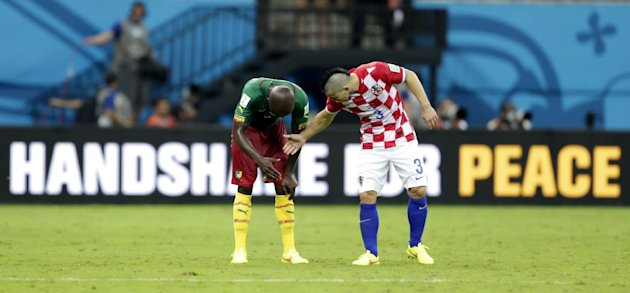 Croatia's Danijel Pranjic, right, shakes hands with Cameroon's Dany Nounkeu after the group A World Cup soccer match between Cameroon and Croatia at t...