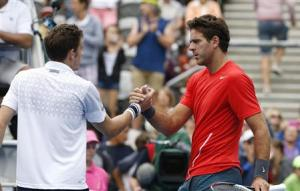 Juan Martin Del Potro of Argentina meets France's Nicolas Mahut of France at the net following his second round men's singles win in Sydney