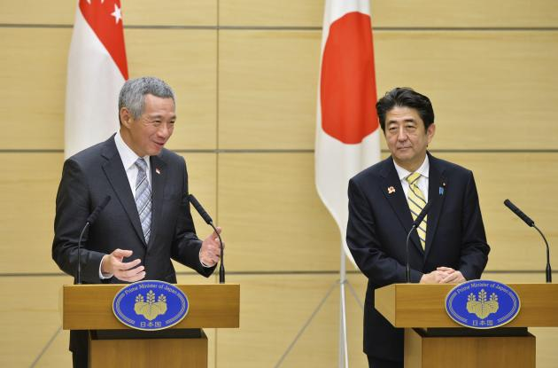 Singapore's Prime Minister Lee speaks next to his Japanese counterpart Abe during their joint news conference in Tokyo