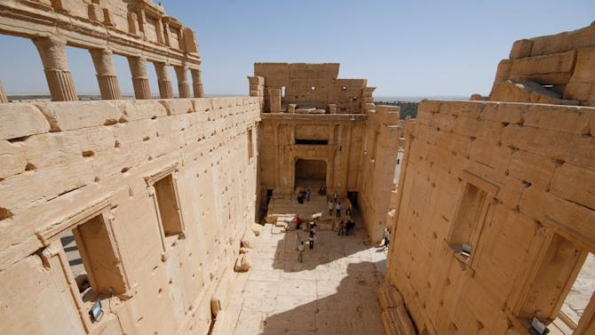 Tourists view the Temple of Bel in the historical city of Palmyra