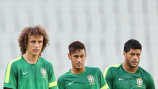 Brazil's David Luiz, left, Neymar, center, and Hulk attend a training session at the Castelao stadium in Fortaleza, Brazil, Tuesday, June 18, 2013. Brazil will face Mexico at the soccer Confederations Cup on June 19. (AP Photo/Andre Penner)