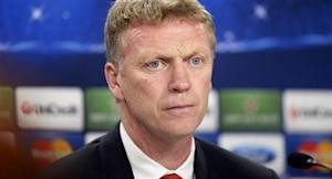 Manchester United manager David Moyes attends a news conference a day before their Champions League soccer match against Real Sociedad at Anoeta stadium in San Sebastian