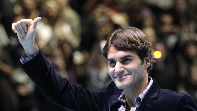 Switzerland's Roger Federer reacts to applauds from the spectators after been presented the Stefan Edberg Sportsmanship award and ATPWorldTour Fans' Favourite award at the ATP World Tour Finals at O2 Arena in London, Monday, Nov. 21, 2011. (AP Photo/Sang Tan)