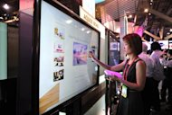 A visitor checks out Sharp's 80-inch touch screen TV set Aquos Board, an Interactive Display System, on the opening day of the International Consumer Electronics Show in Las Vegas, Nevada, on January 10, 2012. Shares Sharp shot up seven percent on Thursday on reports it is in talks with Chinese computer giant Lenovo Group to work together on the production of televisions