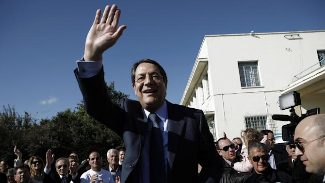Right-wing opposition leader and presidential candidate Nicos Anastasiades waves to his supporters after voting in the Presidential election in southern port city of Limassol, Cyprus, Sunday, Feb. 17, 2013. Cypriots vote for a new president to guide them through a severe economic crisis that has the country joining other troubled European nations in seeking international rescue money to pull it back from the brink of bankruptcy. (AP Photo/Petros Karadjias)