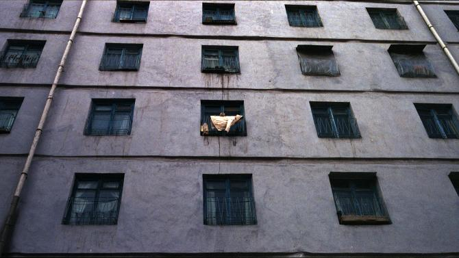 In this Feb. 18, 2012 photo, a coat dries on the balcony of an apartment block in central Pyongyang. (AP Photo/David Guttenfelder)
