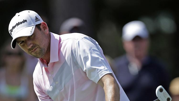 Sergio Garcia, of Spain, gestures as he misses a birdie putt on the seventh hole during the final round of The Players championship golf tournament at TPC Sawgrass, Sunday, May 12, 2013, in Ponte Vedra Beach, Fla.  (AP Photo/Chris O'Meara)