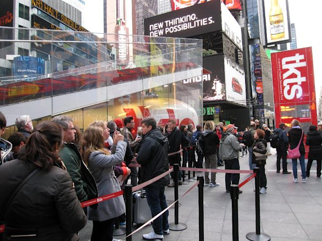 A line of ticket-buyers wait at the TKTS booth, which sells discount tickets to Broadway shows, in New York&#39;s Times Square on Wednesday, Oct. 31, 2012. Most Broadway theaters were reopening Wednesday for regular matinee and evening performances following several days of closures related to superstorm Sandy. (AP Photo/Beth J. Harpaz)