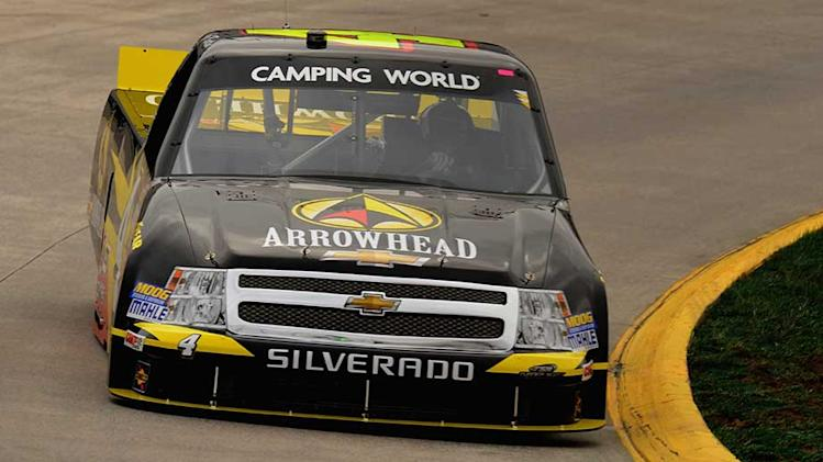Rookie Burton breaks record, takes pole
