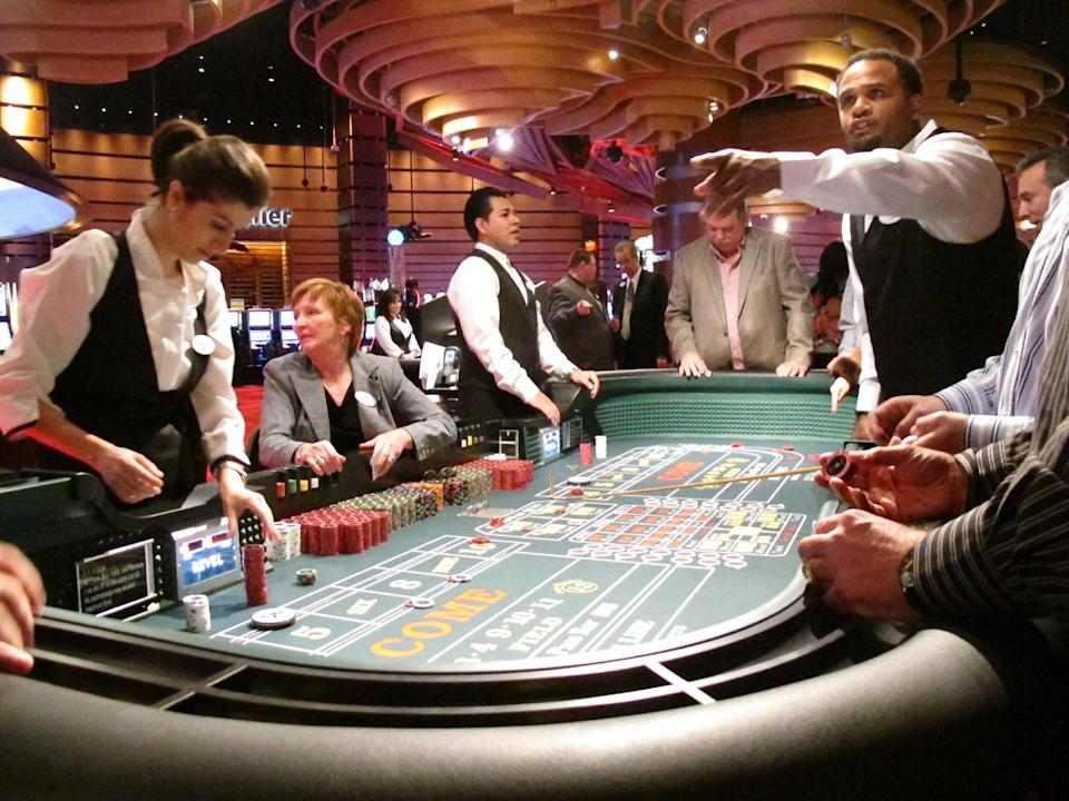 In this March 28, 2012, photo, craps dealers handle bets for customers at Revel, the Atlantic City N.J., casino that had its first invitation-only test night on March 28. The $2.4 billion resort opens its doors to the public on Monday, April 2. (AP Photo/Wayne Parry)