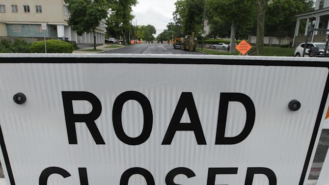 Road construction signs are seen Monday, April 30, 2012 in Springfield, Ill. Much of America's infrastructure, including its interstate highway system, is more than half a century old and in need of serious work to keep pace with a rising population. Highway, rail and airport bottlenecks slow the movement of goods and commuters, costing billions in wasted time and fuel and even measurably slowing the economy. (AP Photo/Seth Perlman)