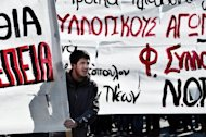 A demonstrator attends a march on February 20, 2013 in Athens during a 24-hour general strike called by leading unions against austerity measures. Greece&#39;s three-party government insists there is no alternative to the harsh austerity programme demanded by the country&#39;s creditors in return for vital loans to stave of bankruptcy