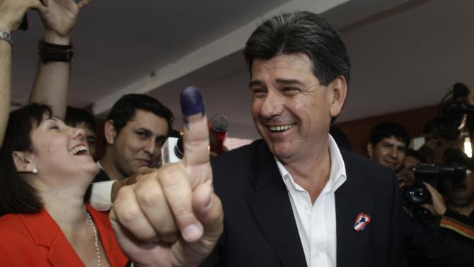 Liberal Party's Presidential candidate Efrain Alegre shows his inked finger which was marked after casting his ballot during general elections in Asuncion, Paraguay, Sunday, April 21, 2013. The elections are an important milestone in Paraguay's attempt to regain the international acceptance it lost when neighboring nations objected to the fast-track removal of President Fernando Lugo. (AP Photo/Cesar Olmedo)