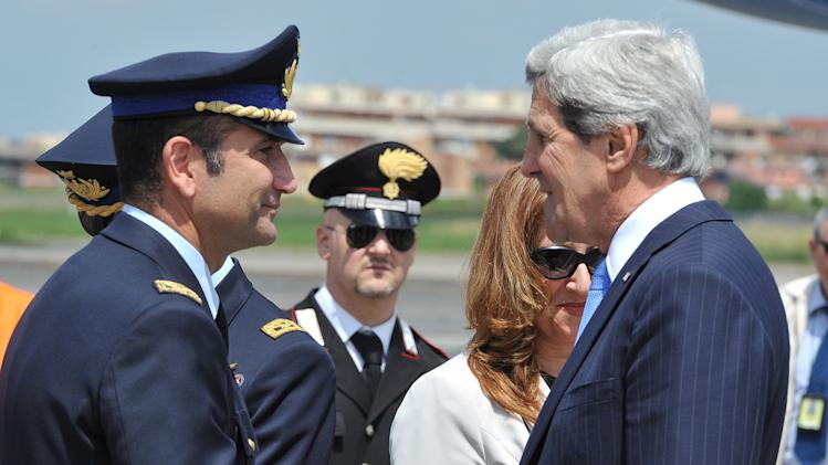 Italian military officers greet US Secretary of State John Kerry, right, on his arrival at Chiampino International Airport in Rome, Wednesday May 8, 2013. Kerry arrived in Rome from Moscow on a two-day visit where he is scheduled to meet new Italian Premier Enrico Letta amongst other appointments. (AP Photo/Mladen Antonov)