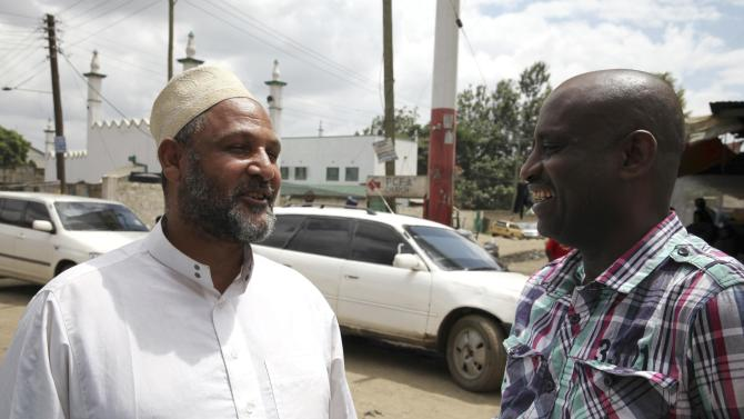 Wanguthi, a Muslim leader, talks to a man near a mosque in Muslim-dominated Eastleigh neighbourhood in Kenya's capital Nairobi