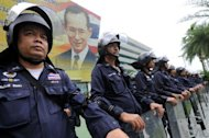 Thai riot policemen stand guard prior to a court ruling on whether plans by Prime Minister Yingluck Shinawatra's party to amend the constitution are legal, at the Constitutional Court in Bangkok on July 13, 2012