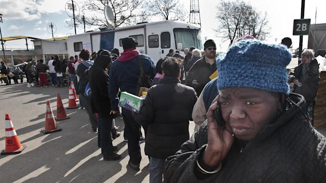 "FILE - In this Nov. 2, 2012 file photo, Evangean Pugh, far right, talks on a phone as she waits on line to apply for recovery assistance from Superstorm Sandy at a FEMA processing center in Coney Island, in the Brooklyn borough of New York. The current term of the U.S Congress is set to end this week with no action on aid for the superstorm that left more than 100 dead and thousands homeless in three northeast states and lawmakers and officials from the area are furious. New York lawmakers from both parties lashed out at the decision by House Republican leaders not to hold a vote on Sandy aid in the current Congress, calling it a ""betrayal."" (AP Photo/Bebeto Matthews, File)"