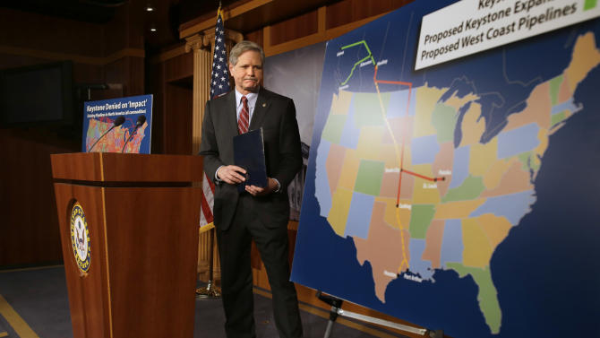 Sen. John Hoeven, R-N.D,  walks toward a illustration of the Keystone Pipeline and proposed expansions, after a news conference on Capitol Hill in Washington, Wednesday, Jan. 23, 2013. A key approval of a revised route for the Keystone XL oil pipeline from Canada to the U.S. Gulf Coast puts the long-delayed project back in the hands of the U.S. government.  (AP Photo/Jacquelyn Martin)
