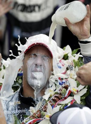 Tony Kanaan, of Brazil, celebrates with winners milk after winning the Indianapolis 500 auto race at the Indianapolis Motor Speedway in Indianapolis, Sunday, May 26, 2013. (AP Photo/Michael Conroy)