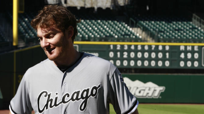 Chicago White Sox starting pitcher Phil Humber briefly stops in view of the scoreboard an hour after pitching a perfect baseball game against the Seattle Mariners, Saturday, April 21, 2012, in Seattle. The White Sox won 4-0. (AP Photo/Elaine Thompson)