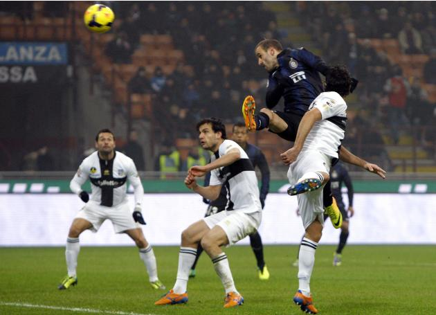 Inter Milan's Palacio heads the ball to score a second goal against Parma during their Italian Serie A soccer match in Milan