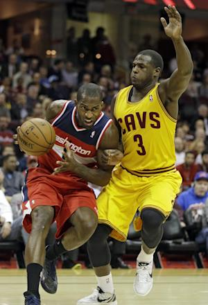 Beal, Nene lead Wizards past Cavaliers 98-91