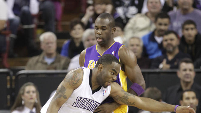 Sacramento Kings guard Marcus Thornton drives against Los Angeles Lakers guard Jodie Meeks during the first quarter of an NBA basketball game in Sacramento, Calif., Wednesday, Nov. 21, 2012. (AP Photo/Rich Pedroncelli)