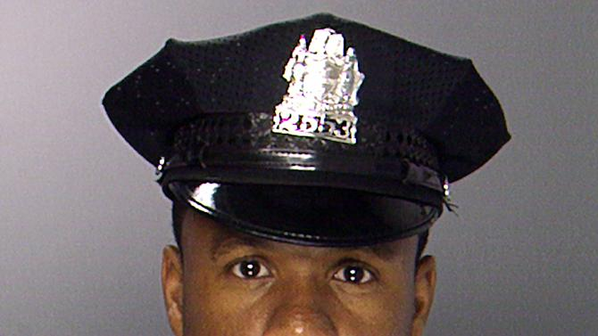 This photo provided by the Philadelphia Police Department shows Officer Moses Walker Jr. Walker was shot and killed, Saturday, Aug. 18, 2012, in North Philadelphia. Police said Walker had just gotten off his overnight shift and was not wearing his uniform as he walked along Cecil B. Moore Avenue, where he was shot multiple times just before 6 a.m., Saturday. Walker, 40, and a 19-year veteran of the Philadelphia Police Department, later died at the hospital. (AP Photo/Philadelphia Police Department)