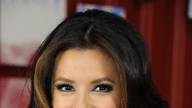 """FILE - In this April 6, 2012 file photo, actress Eva Longoria appears for the new Pepsi Next in New York's Times Square. Lifetime is picking up """"Devious Maids,"""" a new series from """"Desperate Housewives"""" creator Marc Cherry. Eva Longoria is among the executive producers. (AP Photo/Evan Agostini, File)"""