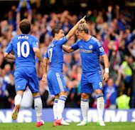 Eden Hazard, left, converted a penalty and Fernando Torres, right, added a second goal against Newcastle