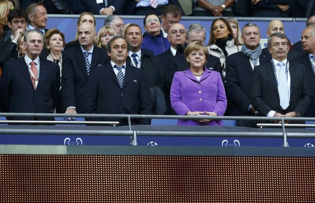 IOC President Rogge, UEFA President Platini and German Chancellor Merkel and DFB President Niersbach wait for the start of the Champions League Final soccer match between Bayern Munich and Borussia Do