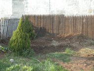 The backyard, after the shrubberies were removed but before the firepit was built.
