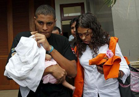 American couple Tommy Schaefer and Heather Mack leave prison with their baby for a Denpasar court in Bali