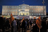Demonstrators gather in front of the parliament in Athens on April 28, 2013. The Greek parliament voted late Sunday to adopt a law that provides for the dismissal of 15,000 civil servants as part of austerity measures imposed by the country's international creditors