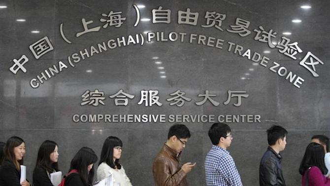 People queue up at an office of the service centre of China (Shanghai) Pilot Free Trade Zone, in Shanghai, October 28, 2013. Picture taken October 28, 2013. REUTERS/China Daily