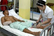 A nurse treats a wounded Philippine soldier at the Camp Navarro General Hospital in the southern Philippine city of Zamboanga. The Philippine military accused Muslim rebels Wednesday of killing 19 soldiers on a remote southern island in one of the worst outbreaks of violence between the two sides in years