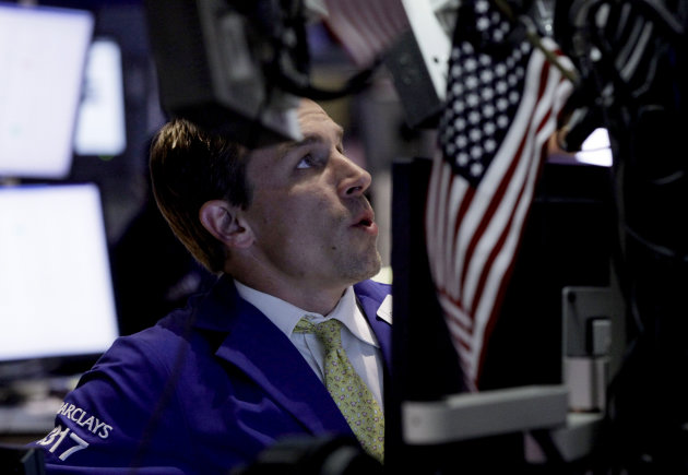 Specialist Christopher Trotta works on the floor of the New York Stock Exchange Monday, June 25, 2012. Wall Street was poised for a muted open Tuesday June 26, 2012, with both Dow futures and the broader S&P 500 futures up 0.2 percent. (AP Photo/Richard Drew)