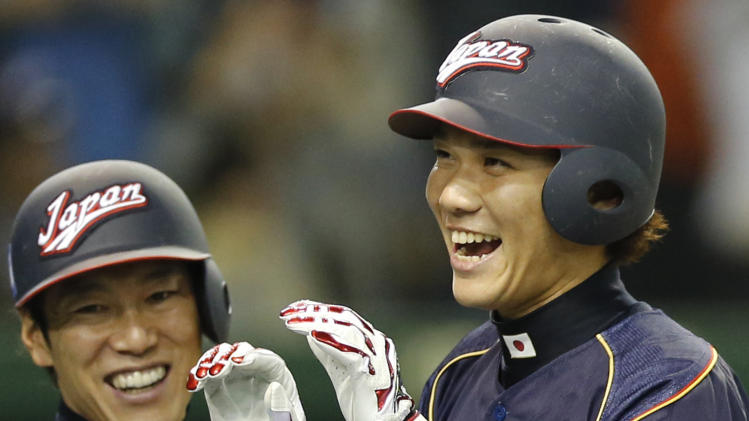 Japan's shortstop Hayato Sakamoto, right, celebrates with teammate Atsunori Inaba after hitting a grand slam off Netherlands' pitcher Berry Van Driel in the seventh inning of their World Baseball Classic second round game at Tokyo Dome in Tokyo, Sunday, March 10, 2013. (AP Photo/Koji Sasahara)