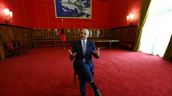 Albanian Prime Minister Edi Rama speaks during an interview with The Associated Press at his office in Tirana, Wednesday, Oct. 22, 2014. Albania's prime minister has told the Associated Press that a heated spat with Serbia over a soccer match triggered by drone would not derail a common effort to seek faster European Union membership. (AP Photo/Hektor Pustina)