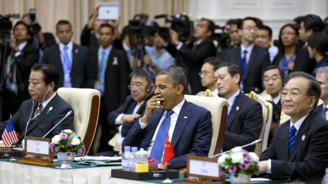 U.S. President Barack Obama yawns at the beginning of the East Asian Summit Plenary Session at the Peace Palace in Phnom Penh, Cambodia, Tuesday, Nov. 20, 2012. Seated left is Japan's Prime Minister Yoshihiko Noda, and right is Chinese Premier Wen Jiabao. (AP Photo/Carolyn Kaster)