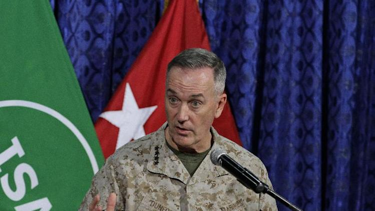 Top U.S. military commander in Afghanistan, Joseph Dunford, talks to media representatives at the ISAF headquarters in Kabul, Afghanistan, Tuesday, June, 18, 2013. Dunford said NATO will support any positive movement to bring reconciliation between the Afghan people and Taliban. American officials say U.S. representatives will begin formal meetings with the Taliban in a few days at the group's new office opening in Qatar. (AP Photo/Ahmad Jamshid)