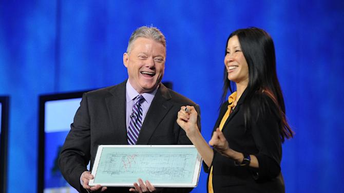 "IMAGE DISTRIBUTED FOR PANASONIC - CEO of Panasonic North America, Joe Taylor, left, and Lisa Ling debut the new Panasonic 20"" 4K Tablet computer during the Panasonic keynote presentation at the International Consumer Electronics Show 2013, on Tuesday, Jan. 08, 2013, in Las Vegas, NV. (Photo by Al Powers/Invision for Panasonic/AP Images)"