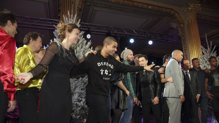 Valerie Trierweiler, companion of French President Hollande, dances with break dancer Brahim Zaiba during the Christmas party at the Elysee Palace