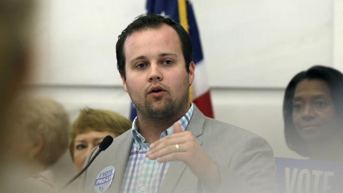 FILE - In this Aug. 29, 2014, file photo, Josh Duggar, executive director of FRC Action, speaks in favor the Pain-Capable Unborn Child Protection Act at the Arkansas state Capitol in Little Rock, Ark. A porn actress has dropped her $500,000 assault lawsuit against Duggar amid evidence that her claims were fabricated. (AP Photo/Danny Johnston, File)