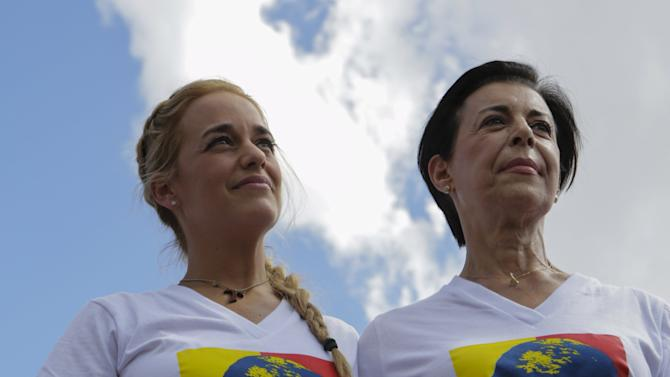 Lilian Tintori, wife of jailed opposition leader Leopoldo Lopez and Lopez's mother Antonieta Mendoza, attend a campaign rally in Caracas
