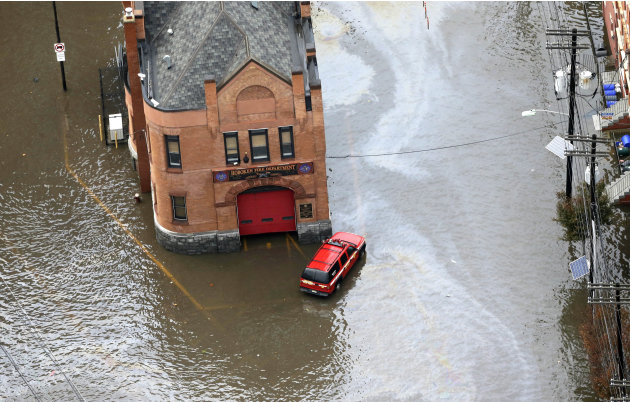 A firehouse is surrounded by floodwaters in the wake of superstorm Sandy on Tuesday, Oct. 30, 2012, in Hoboken, N.J. Sandy, the storm that made landfall Monday, caused multiple fatalities, halted mass