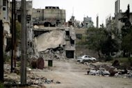 "A general view shows destruction in the Bab Amro neighbourhood of the central restive city of Homs. Rebels killed more than 20 troops on Wednesday in the Syrian army's deadliest day of a three-week-old ceasefire deal, even as UN observers said they were having a ""calming"" impact as they deploy on the ground"
