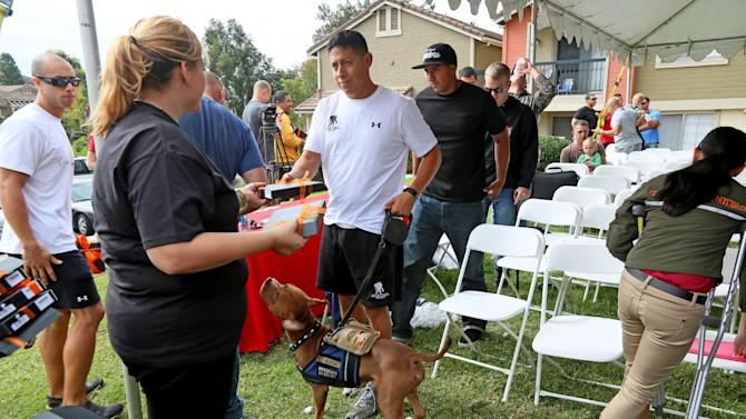 Military personel recieve free Kindles during a Kindle giveaway for wounded sevicr members in Oceanside, CA on Thursday, November 8, 2012.  Amazon is donating over 2,000 Kindles to wounded service members ahead of Veterans Day and is committing to hire 1,200 Veterans in the upcoming year. (Sandy Huffaker /AP Images for Amazon)